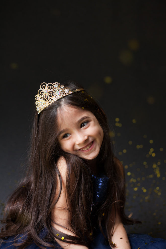 Smiling little girl looking like a princess