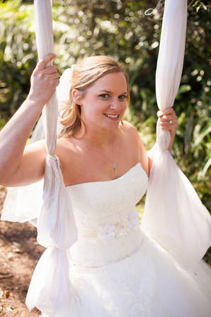 Bride sitting on Swing at laurel Wood Gardens