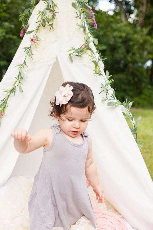 Baby girl walks away from white tent in Tampa FL