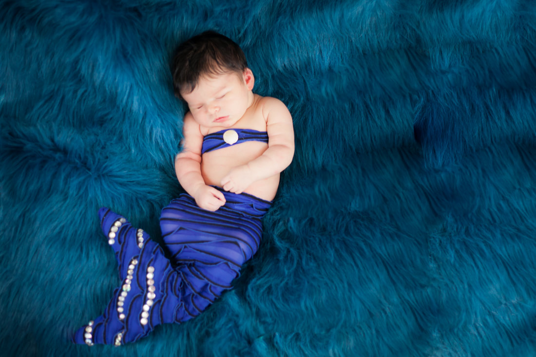 Newborn baby girl dressed as mermaid in Odessa Fl